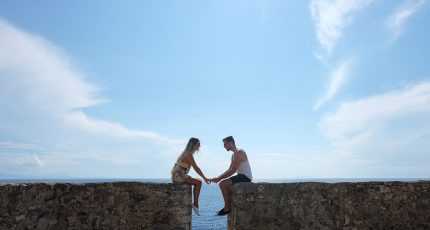 couple holding hands alipasha castle porto palermo