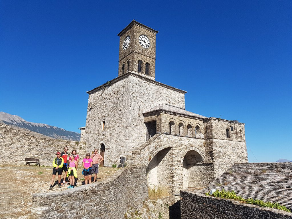 cyclists group gjirokaster castle clock tower
