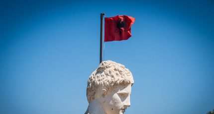dea goddess sculpture unesco butrint albanian flag